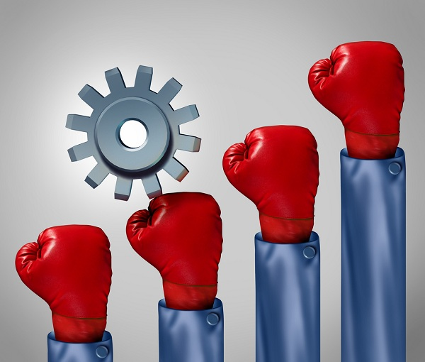 Competitive climb and overcoming adversity business concept and symbol for conquering challenges as a single gear or cog climbing a rising group of red boxing gloves representing competition.